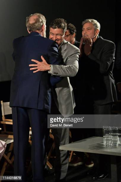 Hugh Laurie Kyle Chandler and George Clooney attend the London Premiere of new Channel 4 show Catch22 based on Joseph Heller's novel of the same name...