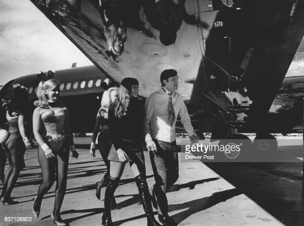 Hugh M Hefner with Girl Friend Barbie Benton and a number of Denver Playboy Club business pass Beneath wing of his plane ***** took delivery of the...