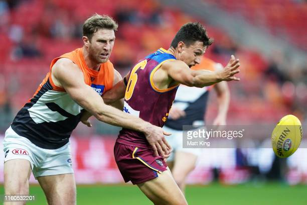 Hugh McCluggage of the Lions is challenged by Dawson Simpson of the Giants during the round 16 AFL match between the Greater Western Sydney Giants...