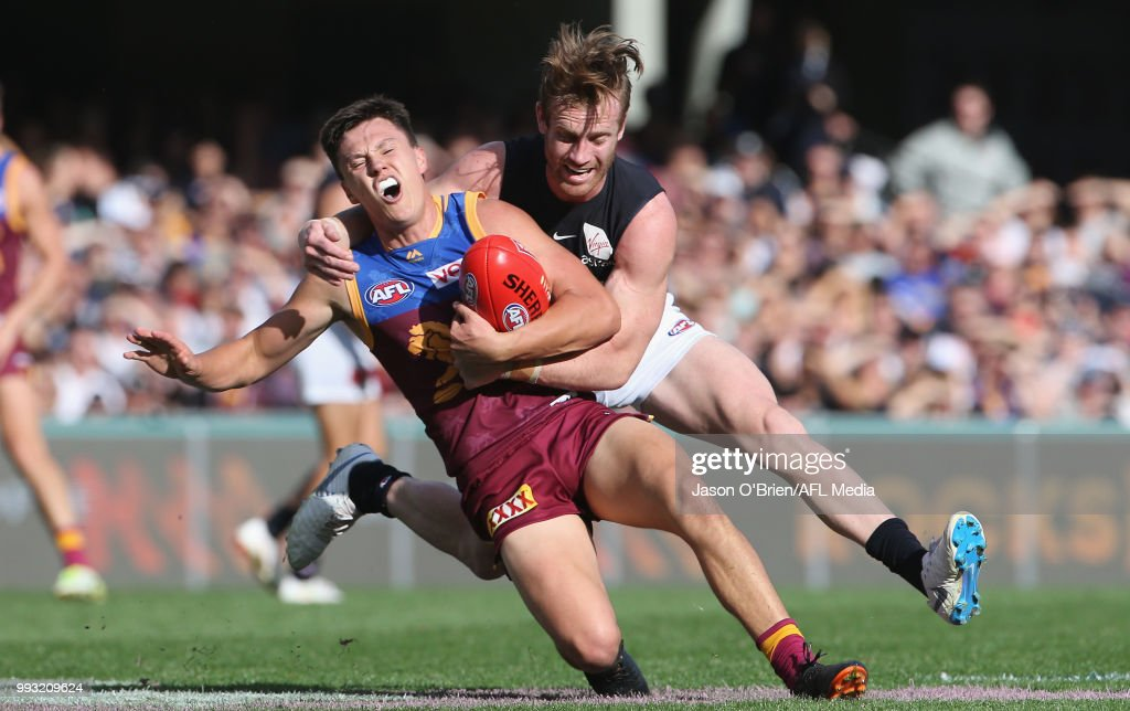 Hugh McCluggage of the lions is tackled high during the round 16 AFL match between the Brisbane Lions and the Carlton Blues at The Gabba on July 7, 2018 in Brisbane, Australia.
