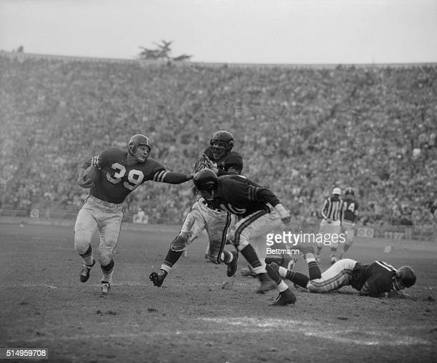 Hugh McElhenny San Francisco 49er halfback and leading groundgainer in the National Football League suffered a complete shoulder separation when...
