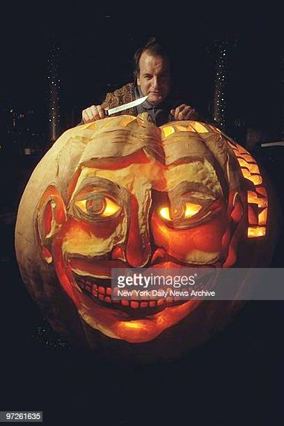 Hugh McMahon in the Kit Kat Club with 600 lb pumpkin in which he carved the Coney Island face