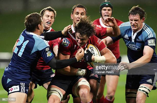 Hugh McMeniman of the Reds tries to get away from Jimmy Gopperth of the Blues during the round 11 Super 14 match between the Blues and the Reds at...