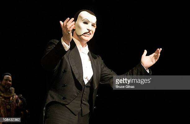 """Hugh Panaro as """"the Phantom"""" celebrates onstage at The 23rd Anniversary of """"The Phantom Of The Opera"""" on Broadway at The Majestic Theatre on January..."""