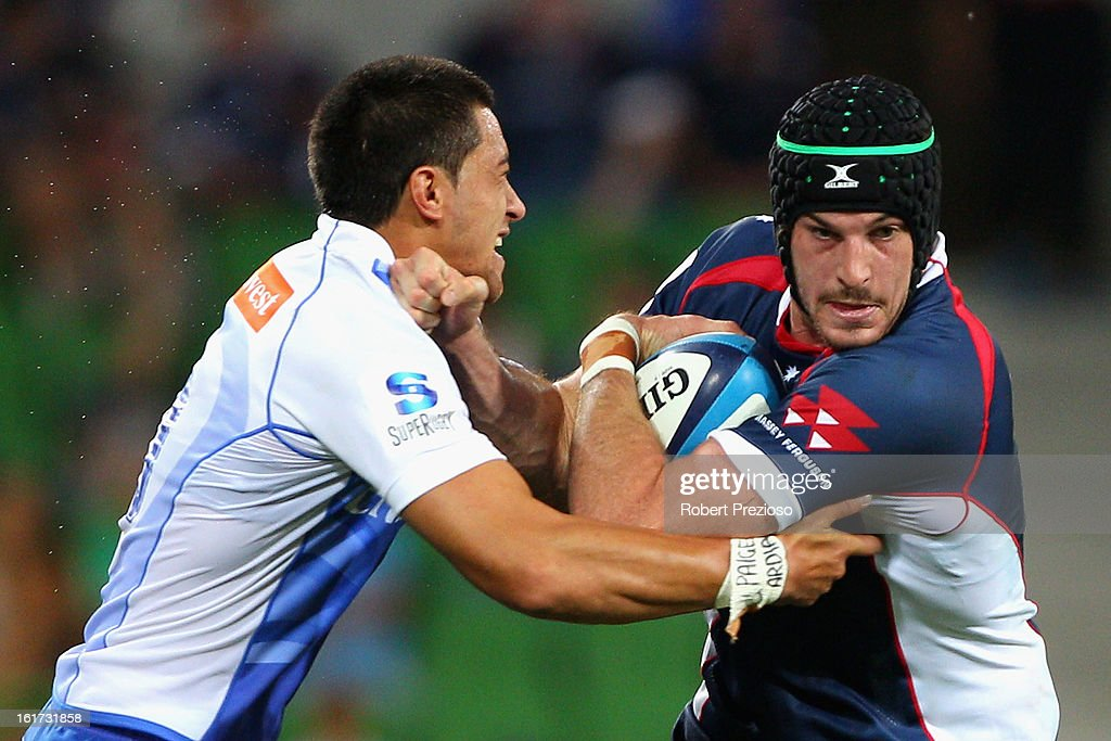 Hugh Pyle of the Rebels is tackled by Sam Christie of the Force during the round one Super Rugby match between the Rebels and the Force at AAMI Park on February 15, 2013 in Melbourne, Australia.