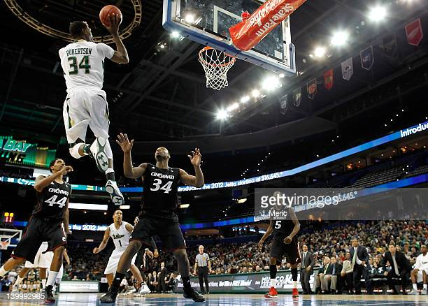 Hugh Robertson of the South Florida Bulls drives to the basket against the Cincinnati Bearcats during the game at the Tampa Bay Times Forum on...