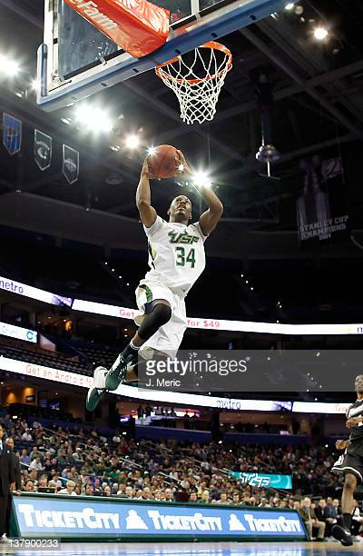 Hugh Robertson of the South Florida Bulls dunks against the Providence Friars during the game at the Tampa Bay Times Forum on January 29 2012 in...