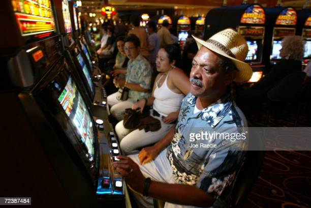 Hugh Salmon and Nada Salmon play slot machines May 11 2004 during the grand opening for the Seminole Hard Rock Hotel and Casino in Hollywood Florida...
