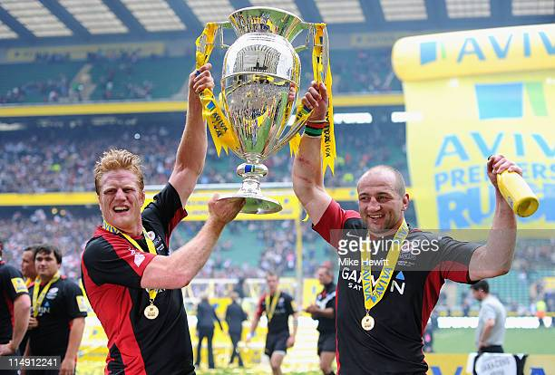 Hugh Vyvyan and captain Steve Borthwick of Saracens lift the trophy after the AVIVA Premiership Final between Leicester Tigers and Saracens at...