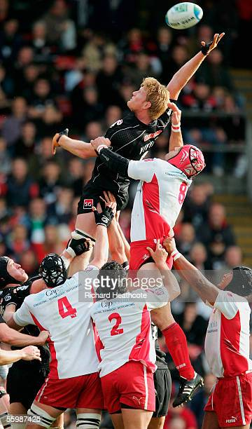 Hugh Vyvyan of Saracens wins lineout ball under pressure from Imanol Harinordoquy of Biarritz during the Heineken Cup match between Saracens and...