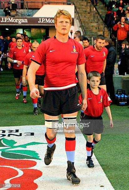 Hugh Vyvyan of the H4H Northern Hemisphere XV leads out his team prior to kickoff during the Help For Heroes Rugby Challenge match between the H4H...