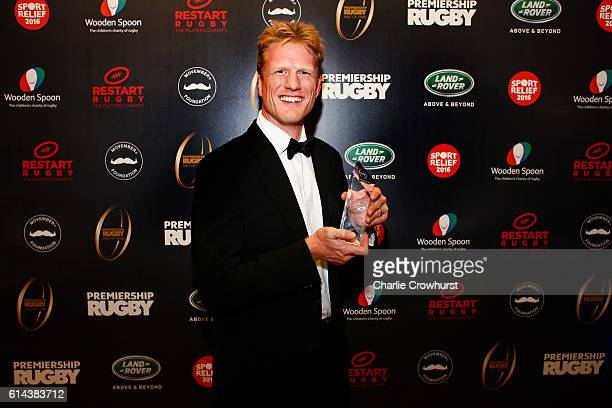 Hugh Vyvyan poses for a photo with his award having been inducted into the hall of fame during the Premiership Rugby Hall of Fame Dinner at...