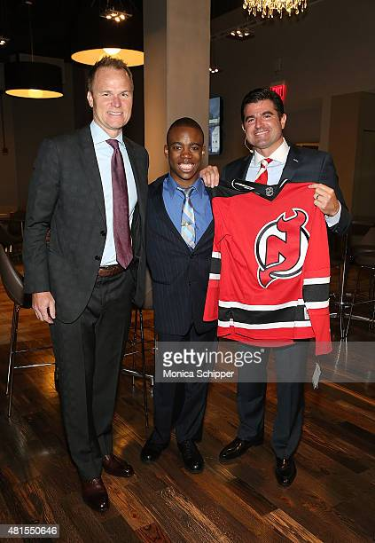 Hugh Weber President at New Jersey Devils Ben Jackson and Scott O'Neil CEO Philadelphia 76ers New Jersey Devils and Prudential Center pose for a...