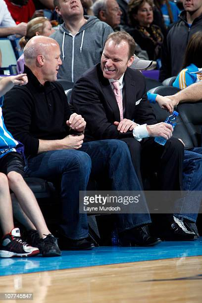 Hugh Weber President of the New Orleans Hornets talks with New Orleans Mayor Mitch Landrieu during a game between the New Orleans Hornets and the New...
