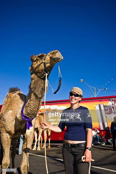 A jockey and her camel awarded after completing an endurance race.