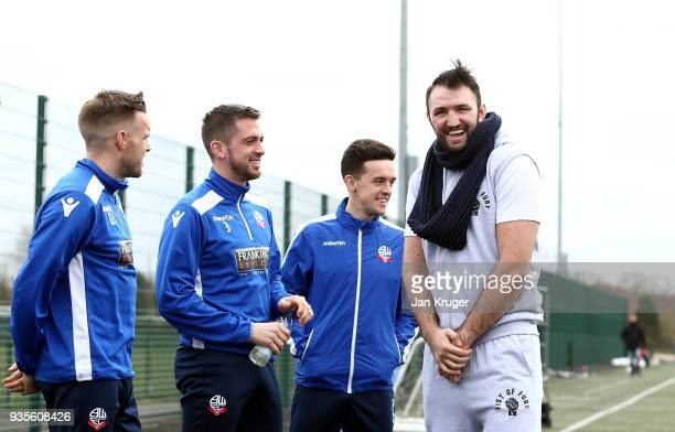 Hughie Fury chats with Zach Clough Andrew Taylor and Craig Noone of Bolton during a media workout at Bolton Wanderers FC Academy on March 21 2018 in...