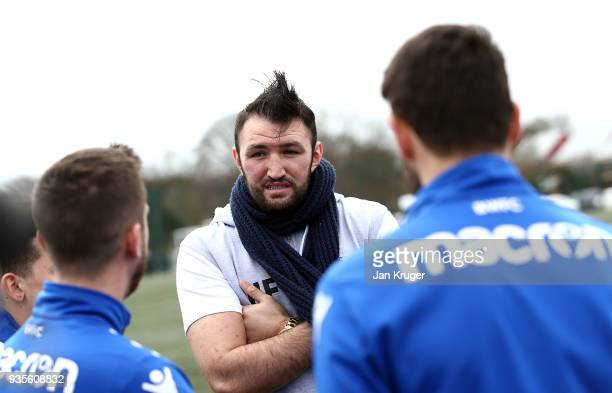 Hughie Fury chats with Zach Clough Andrew Taylor Craig Noone and William Buckley of Bolton during a media workout at Bolton Wanderers FC Academy on...