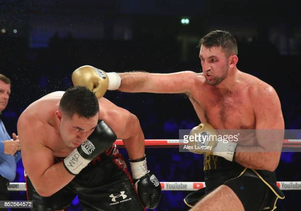 Hughie Fury lands a right shot on Joseph Parker during the WBO World Heavyweight Title fight at Manchester Arena on September 23 2017 in Manchester...