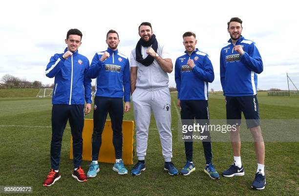 Hughie Fury poses with Zach Clough Andrew Taylor Craig Noone and William Buckley of Bolton during a media workout at Bolton Wanderers FC Academy on...