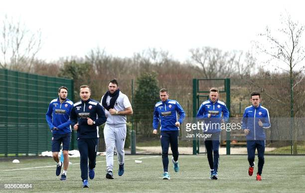 Hughie Fury warms up with Zach Clough Andrew Taylor Craig Noone and William Buckley of Bolton during a media workout at Bolton Wanderers FC Academy...