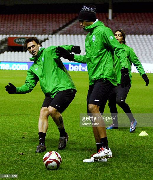 Hugo Almeida and Naldo compete for the ball during the training session at the Estadio San Mames on December 15 2009 in Bilbao Spain