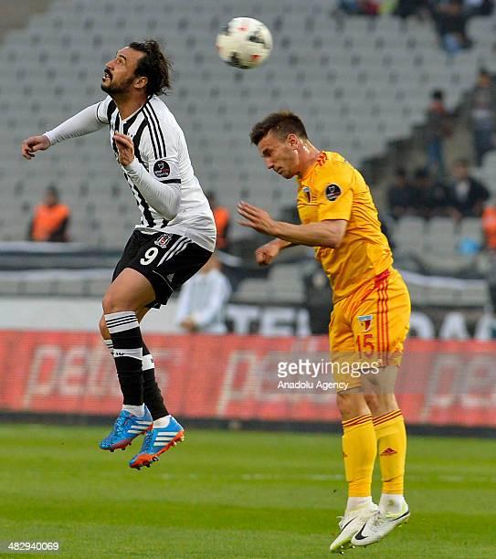 Hugo Almeida of Besiktas vies with Marko Simic of Kayserispor during the Turkish Spor Toto Super League football match between Besiktas and...
