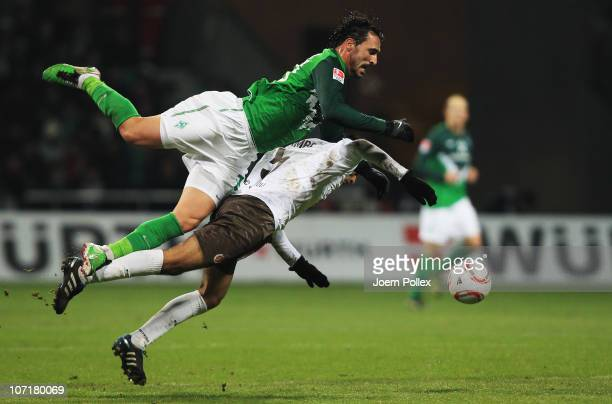 Hugo Almeida of Bremen and Carlos Zambrano of Hamburg battle for the ball during the Bundesliga match between SV Werder Bremen and FC St. Pauli at...