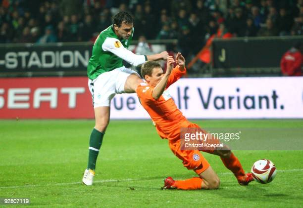 Hugo Almeida of Bremen and Florian Klein of Austria battle for the ball during the UEFA Europa League Group L match between Werder Bremen and Austria...