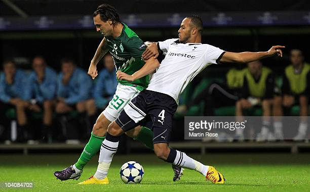 Hugo Almeida of Bremen and Younes Kaboul of Tottenham compete for the ball during the UEFA Champions League group A match between SV Werder Bremen...