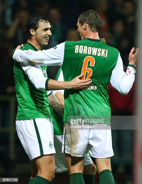 Hugo Almeida of Bremen celebrates scoring his team's second goal with team mate Tim Borowski who scored the first goal during the UEFA Europa League...
