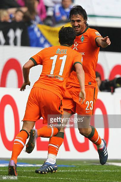 Hugo Almeida of Bremen celebrates the second goal with Mesut Oezil during the Bundesliga match between FC Schalke 04 and SV Werder Bremen at Veltins...