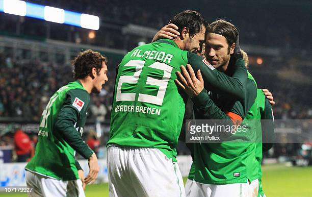 Hugo Almeida of Bremen celebrates with Torsten Frings after scoring his team's third goal during the Bundesliga match between SV Werder Bremen and FC...
