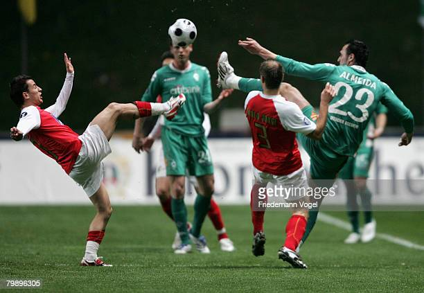 Hugo Almeida of Bremen fights for the ball with Jose Manuel of Braga during the UEFA Cup round of 32 second leg match between SC Braga and Werder...