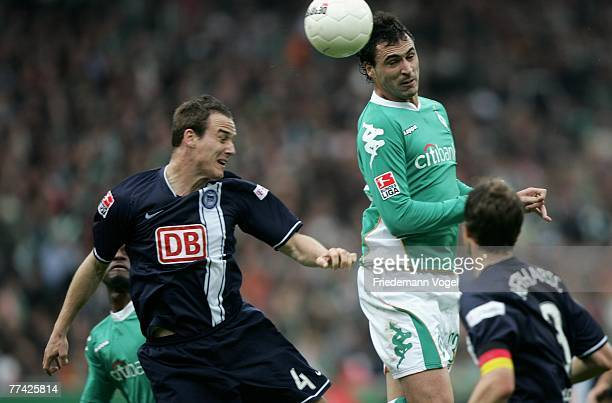 Hugo Almeida of Bremen fights for the ball with Steve von Bergen during the Bundesliga match between Werder Bremen and Hertha BSC Berlin at the Weser...