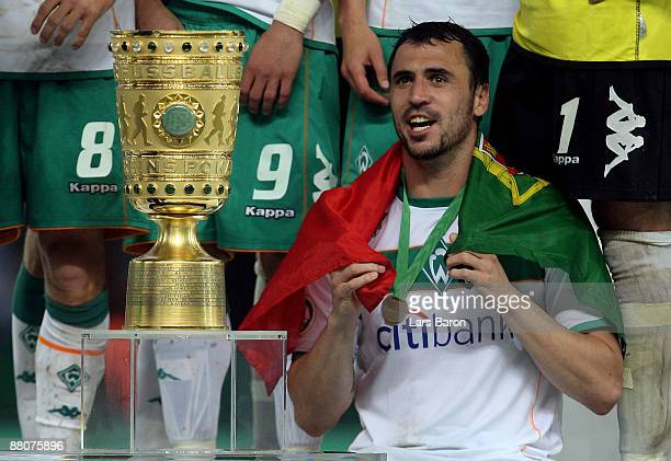 Hugo Almeida of Bremen looks to the trophy after winning during the DFB Cup Final match between Bayer 04 Leverkusen and SV Werder Bremen at Olympic...