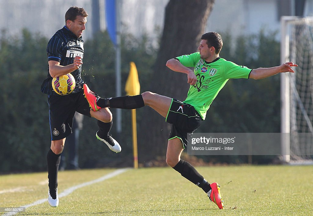 Hugo Armando Campagnaro (L) of FC Internazionale Milano competes for the ball during FC Internazionale training session at the club's training ground on February 11, 2015 in Como, Italy.