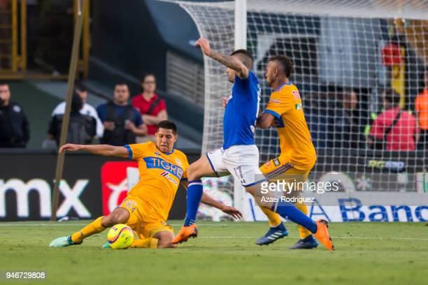 Hugo Ayala and Rafael De Souza of Tigres fight for the ball with Edgar Mendez of Cruz Azul during the 15th round match between Tigres UANL and Cruz...