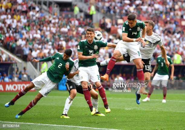 Hugo Ayala Hector Moreno and Javier Hernandez compete for the ball with Thomas Mueller of Germany during the 2018 FIFA World Cup Russia group F match...