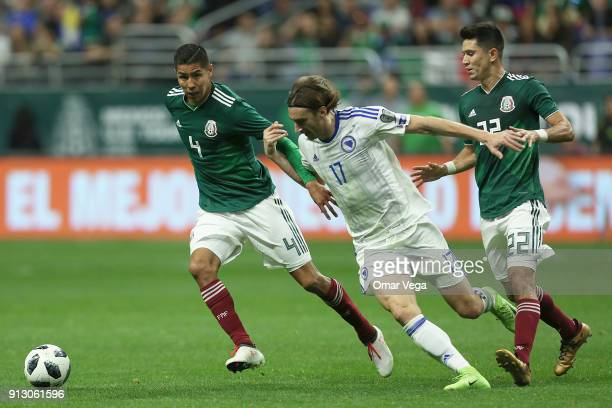 Hugo Ayala of Mexico fights for the ball with Mersudin Ahmetovic of Bosnia and Herzegovina during the friendly match between Mexico and Bosnia and...