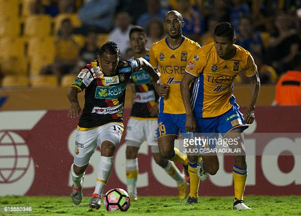 Hugo Ayala of Mexico's Tigres vies for the ball with jose Sanchez of Costa RIca's Herediano during the CONCACAF Champions League football match at...