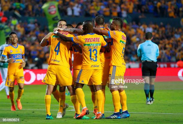 Hugo Ayala of Tigres celebrates with teammates after scoring the first goal of his team during the quarter finals first leg match between Tigres UANL...