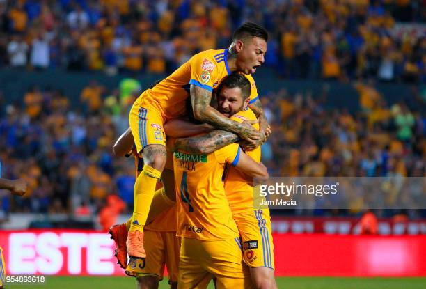 Hugo Ayala of Tigres celebrates with teammates Andre-Pierre Gignac and Eduardo Vargas after scoring the first goal of his team during the quarter...