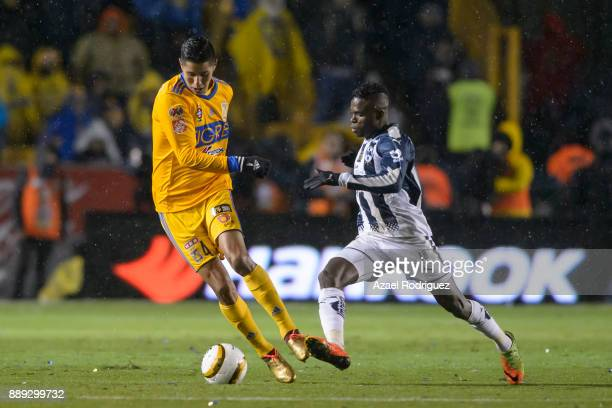 Hugo Ayala of Tigres fights for the ball with Aviles Hurtado of Monterrey during the first leg of the Torneo Apertura 2017 Liga MX final between...