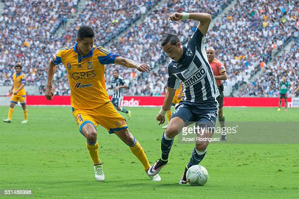 Hugo Ayala of Tigres fights for the ball with Rogelio Funes Mori of Monterrey during the quarter finals second leg match between Monterrey and Tigres...
