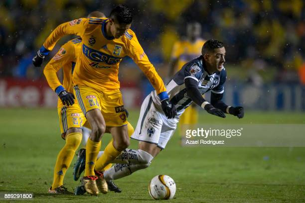 Hugo Ayala of Tigres fights for the ball with Rogelio Funes Mori of Monterrey during the first leg of the Torneo Apertura 2017 Liga MX final between...