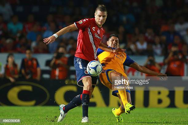 Hugo Ayala of Tigres struggles for the ball with Julio Cesar Furch of Veracruz during the 16th round match between Veracruz and Tigres UANL as part...