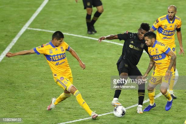 Hugo Ayala of Tigres UANL and Javier Aquino of Tigres UANL defends against Jose Cifuentes of Los Angeles FC during the CONCACAF Champions League...