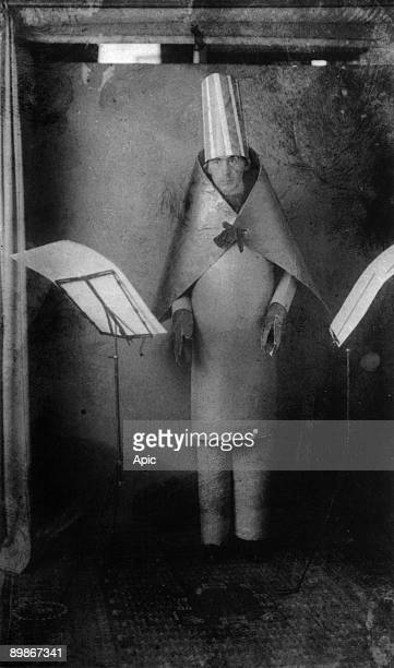 Hugo Ball Dadaist writer and poet, here wearing a cubist suit made by himself and MarcelJanco for reciting of his poems at cabaret Voltaire, Zurich,...