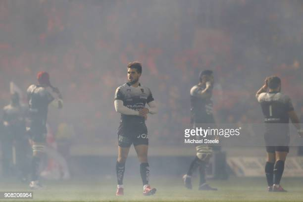 Hugo Bonneval of Toulon is shrouded in pyrotechnics smoke ahead of kick off during the European Rugby Champions Cup match between Scarlets and RC...
