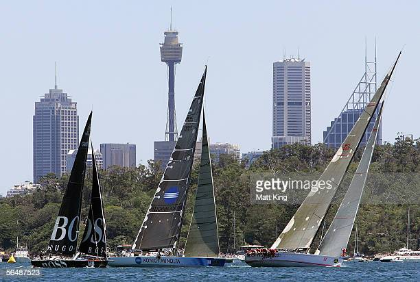 Hugo Boss Konica Minolta and Wild Oats XI compete at the start of the 61st Sydney to Hobart yacht race December 26 2005 in Sydney Australia A fleet...